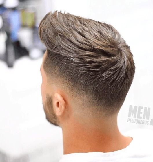 back view of a man with a peak hairstyle