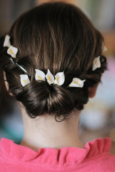 elegant updos for short hair: romantic updos for short hair look great with flowers like this french twist