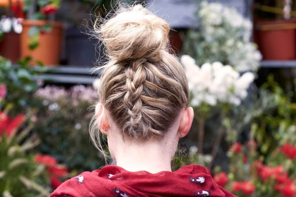 blonde bun with French braided back