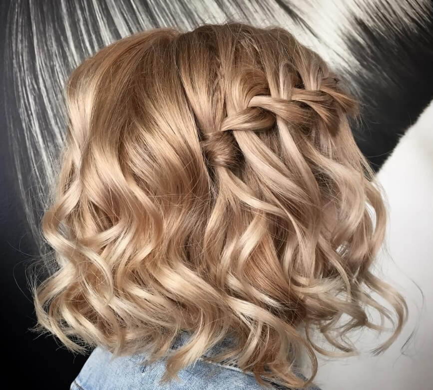 should length blonde hair with a waterfall braid and loose curls