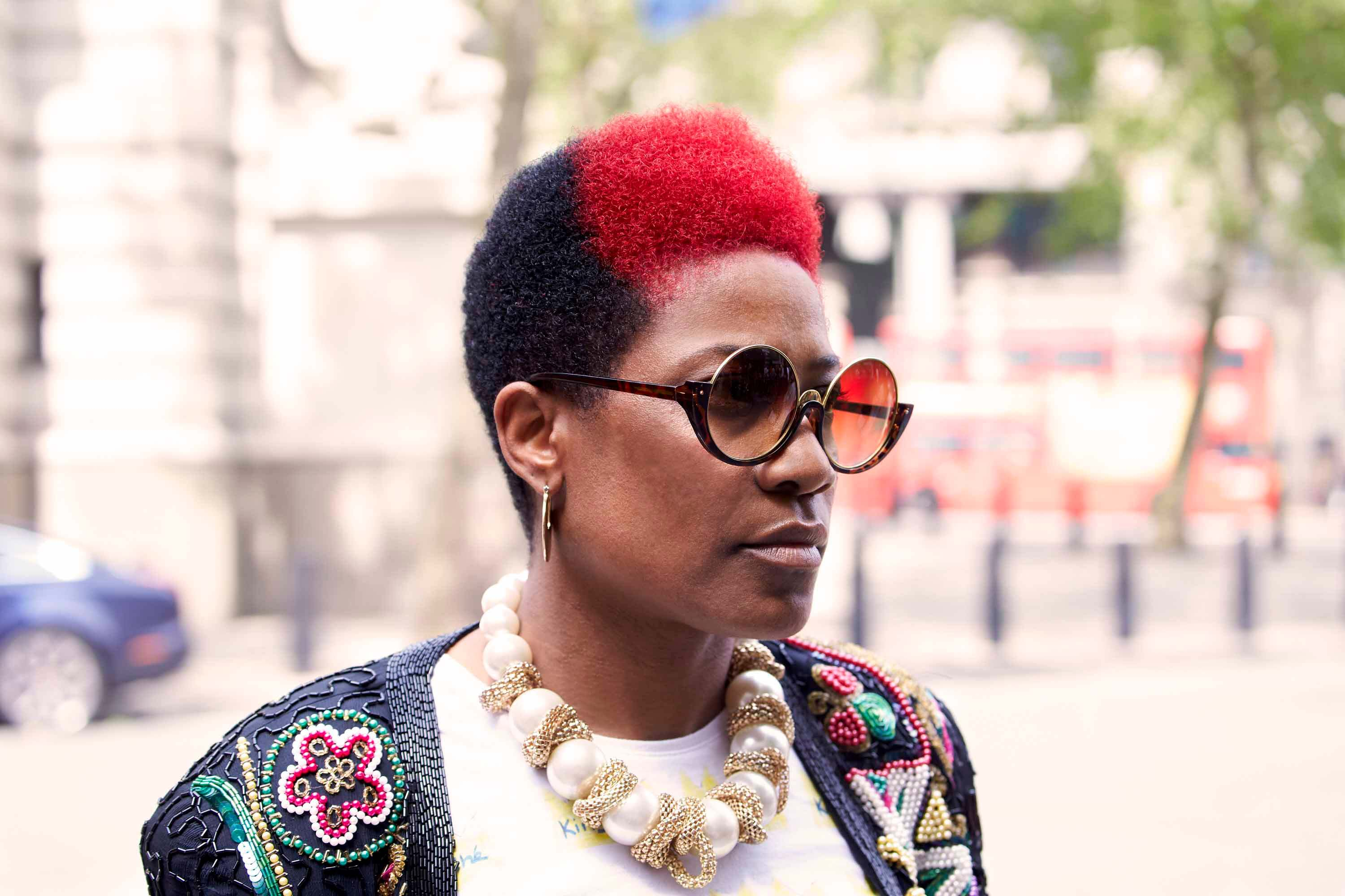 Afro hairstyles: black woman with two toned black and red afro
