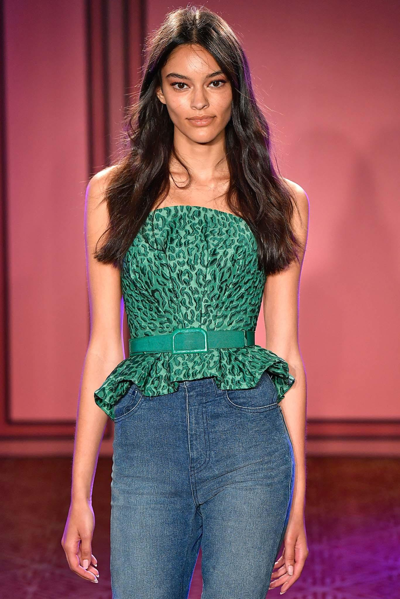 model on catwalk with long brown beach waves