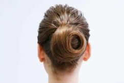 The back view of a beautifully swirled hair bun