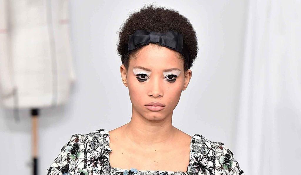 chanel couture aw16 model with a short afro and a bow hairband