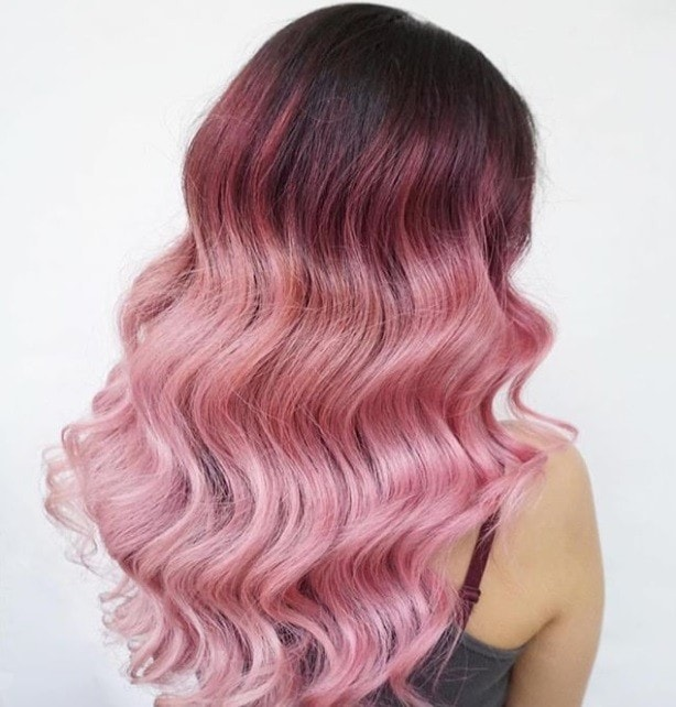 Back Shot Of Woman Wavy Long Hair With Candyfloss Pink Ombre Melt Posing In A
