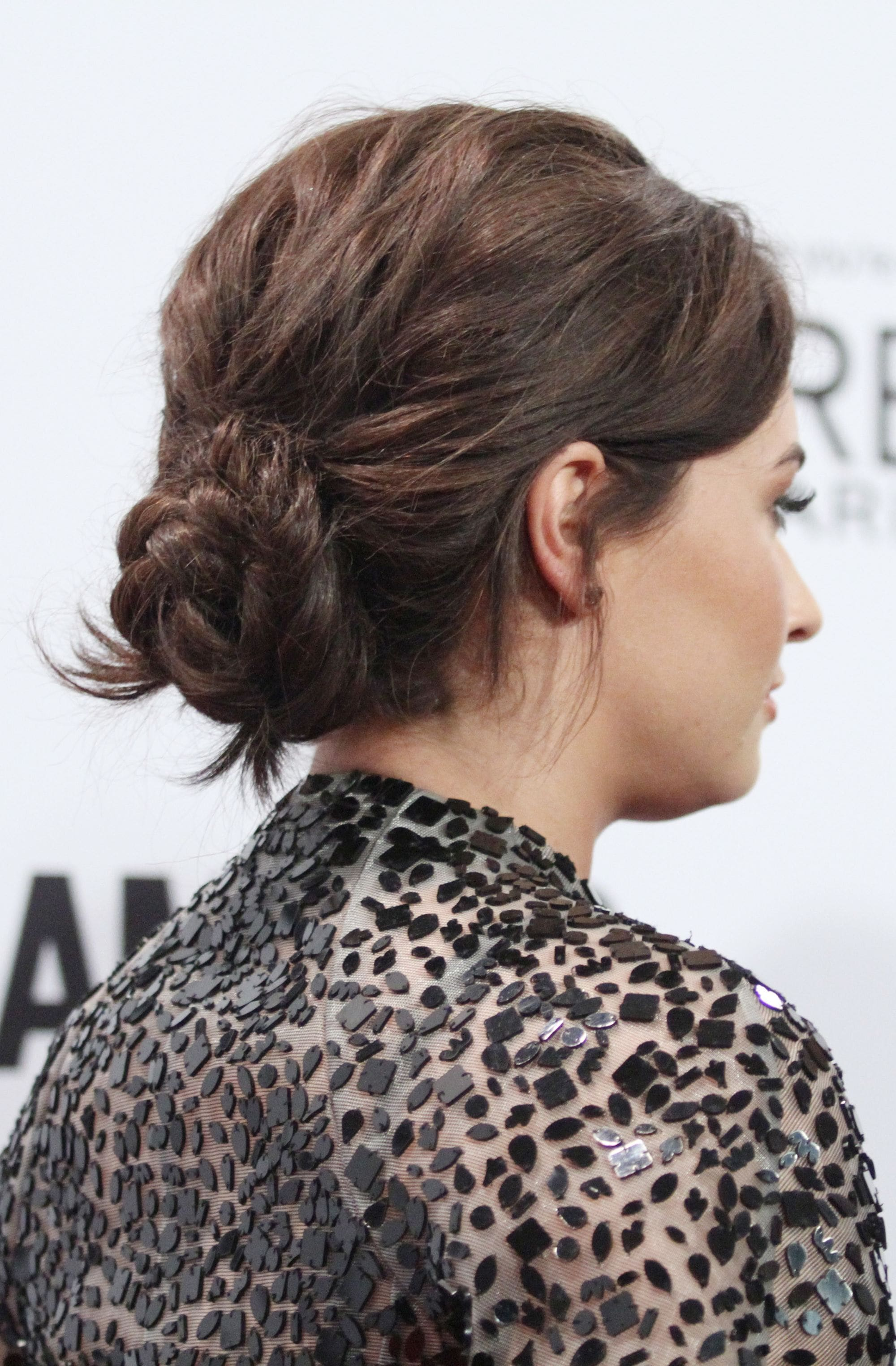 back view of demi lovato with brown low braided bun at Glamour women of the year awards