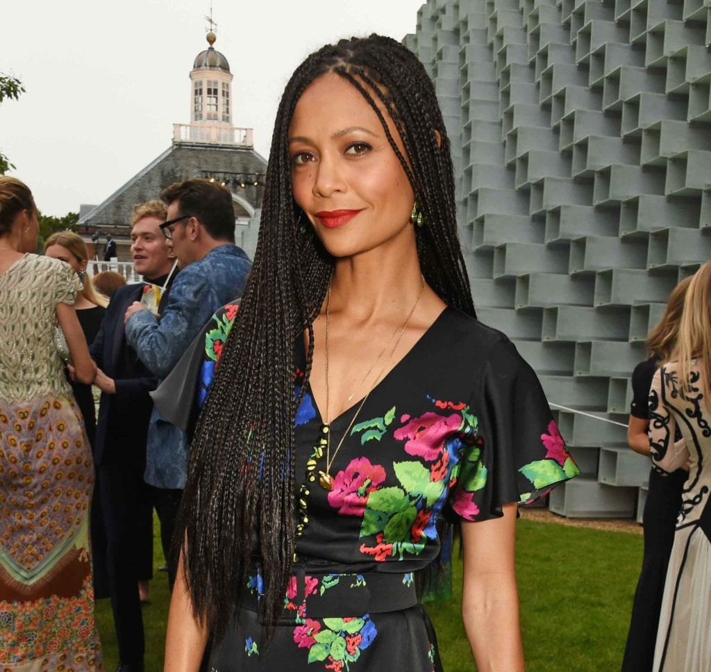 Thandie Newton at the serpentine summer party with long box braids, wearing a black and floral dress