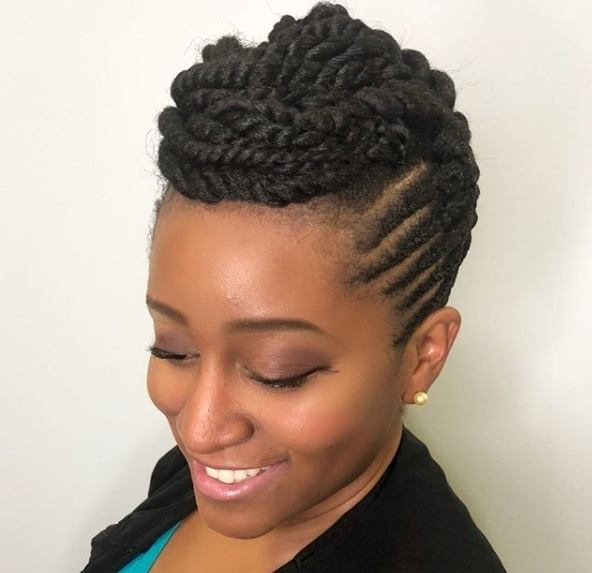 woman with an intricate twisted natural hair updo