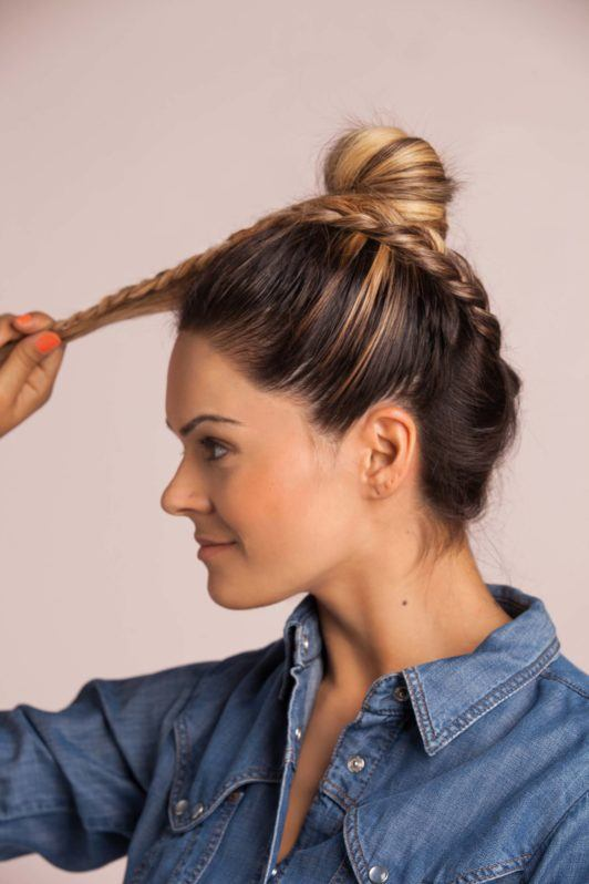 braid top knot: a blonde woman wrapping her braid around her top knot