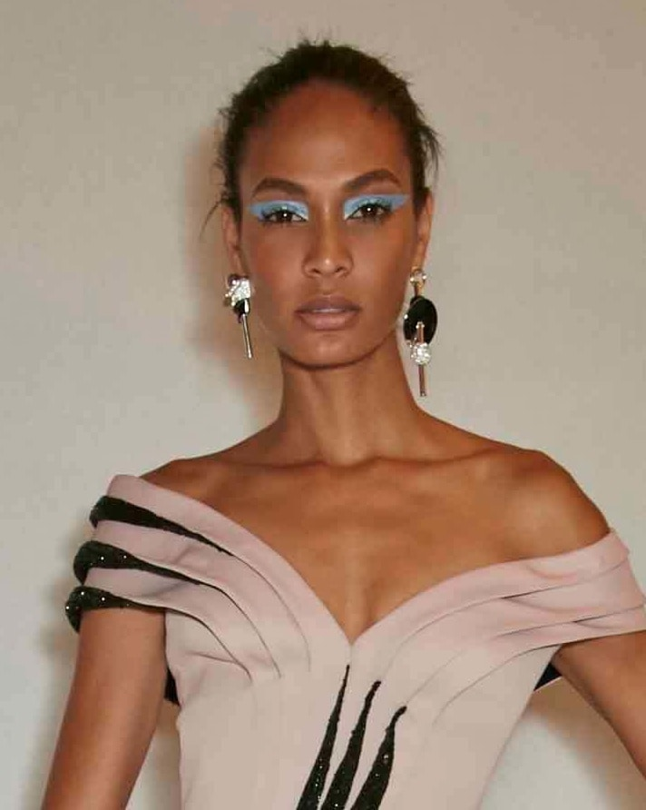 Joan smalls with wind swept hair