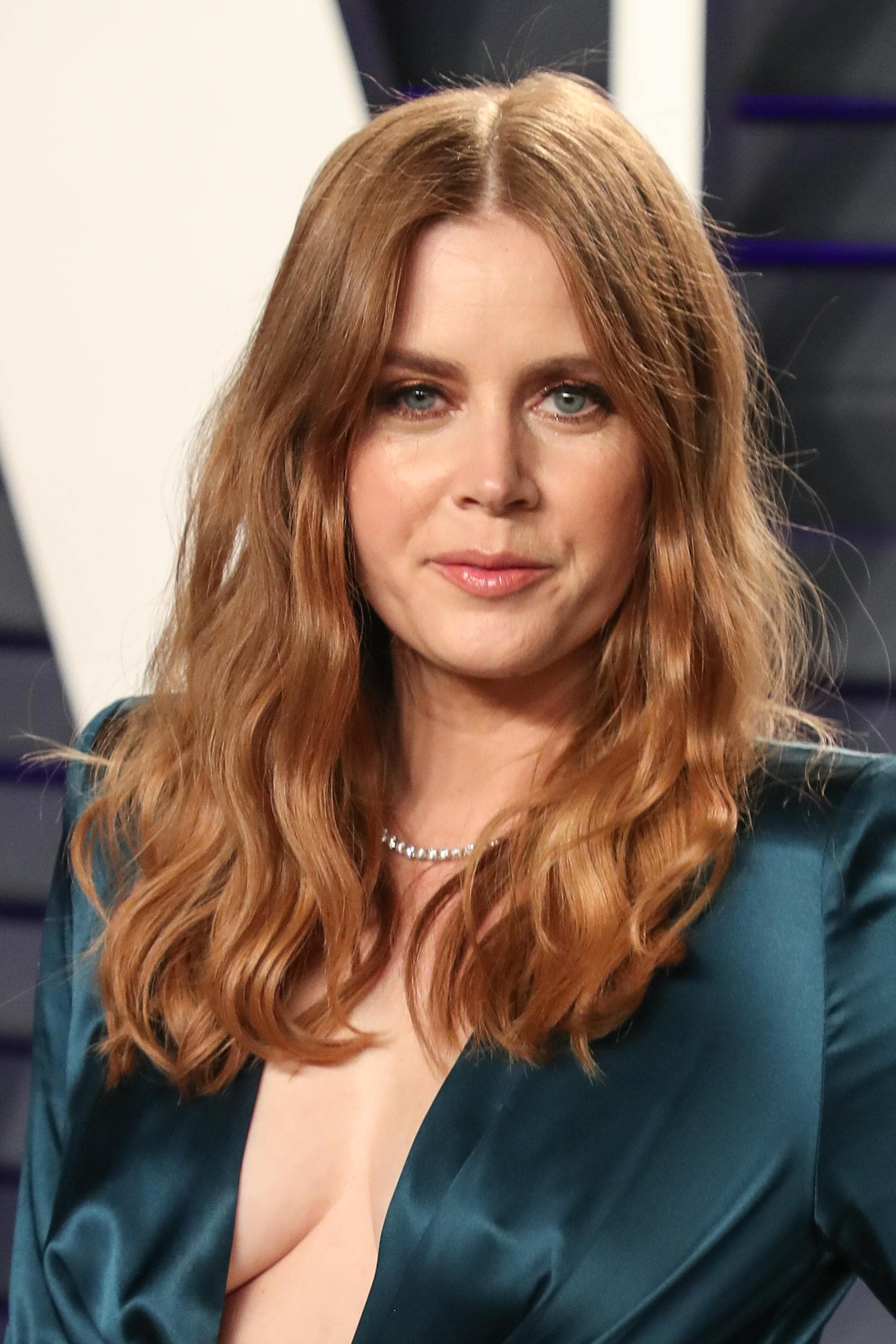 Styles for thick hair: Amy Adams with strawberry blonde medium thick hair styled into beachy waves