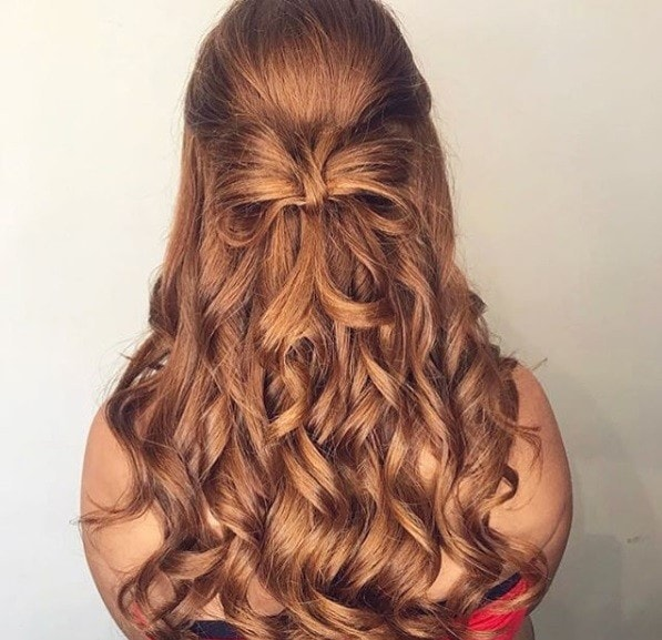 Wedding hairstyles for long hair: Auburn hair in a half-up bow curly hairstyle