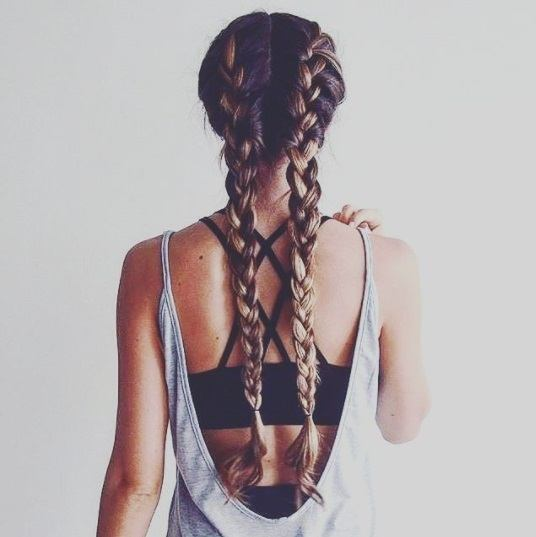back view of a woman with long boxer braids