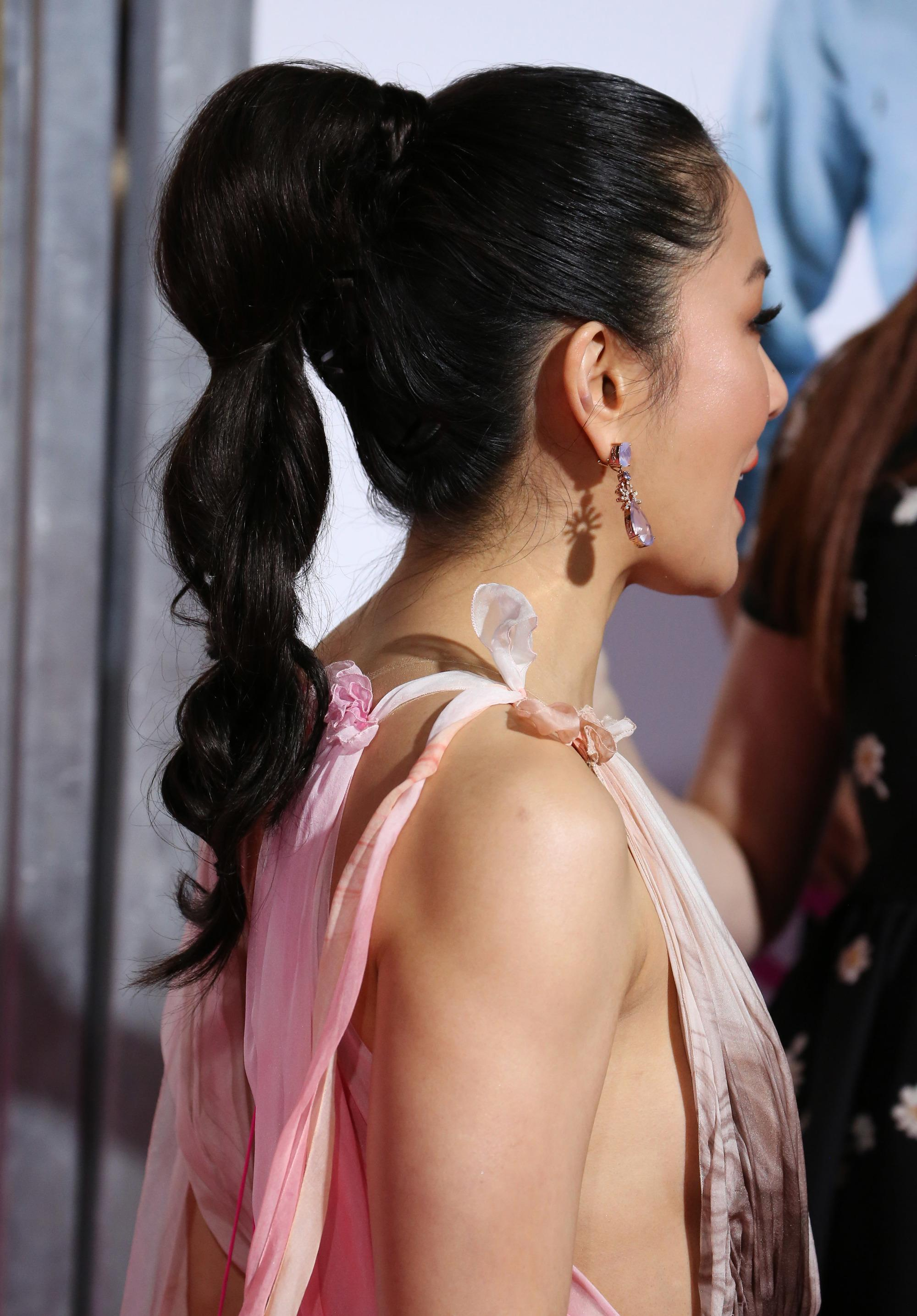 Hairstyles for thick hair: Constance Wu with long thick hair styled into a bubble ponytail