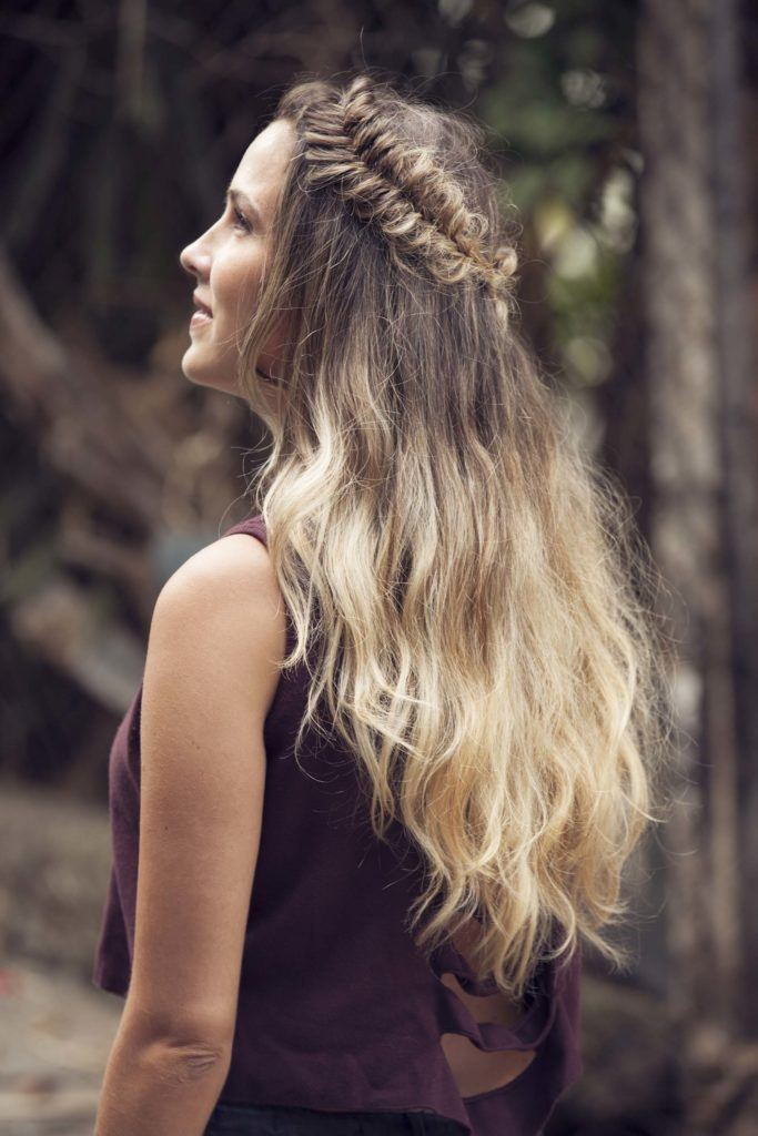 side view of blonde model with a half-up half-down curly fishtail crown