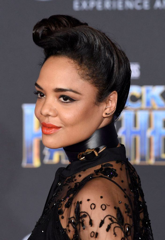 Vintage short hair: Close up shot of Tessa Thompson with dark brown relaxed hair styled into a high rolled quiff on the red carpet