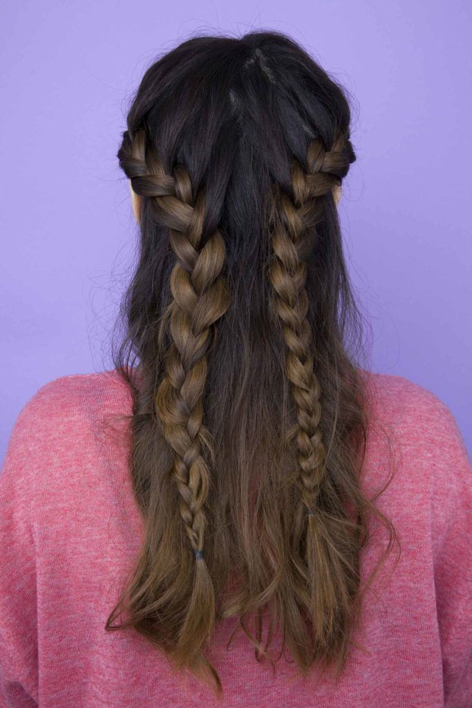 back view of model with brunette hair and half-up, half-down french braids