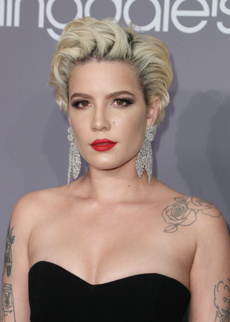 Vintage short hair: Close up shot of Halsey with platinum short blonde hair styled into a loose Marilyn Monroe style curls