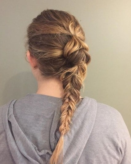 back view of a woman with a fishtail braid
