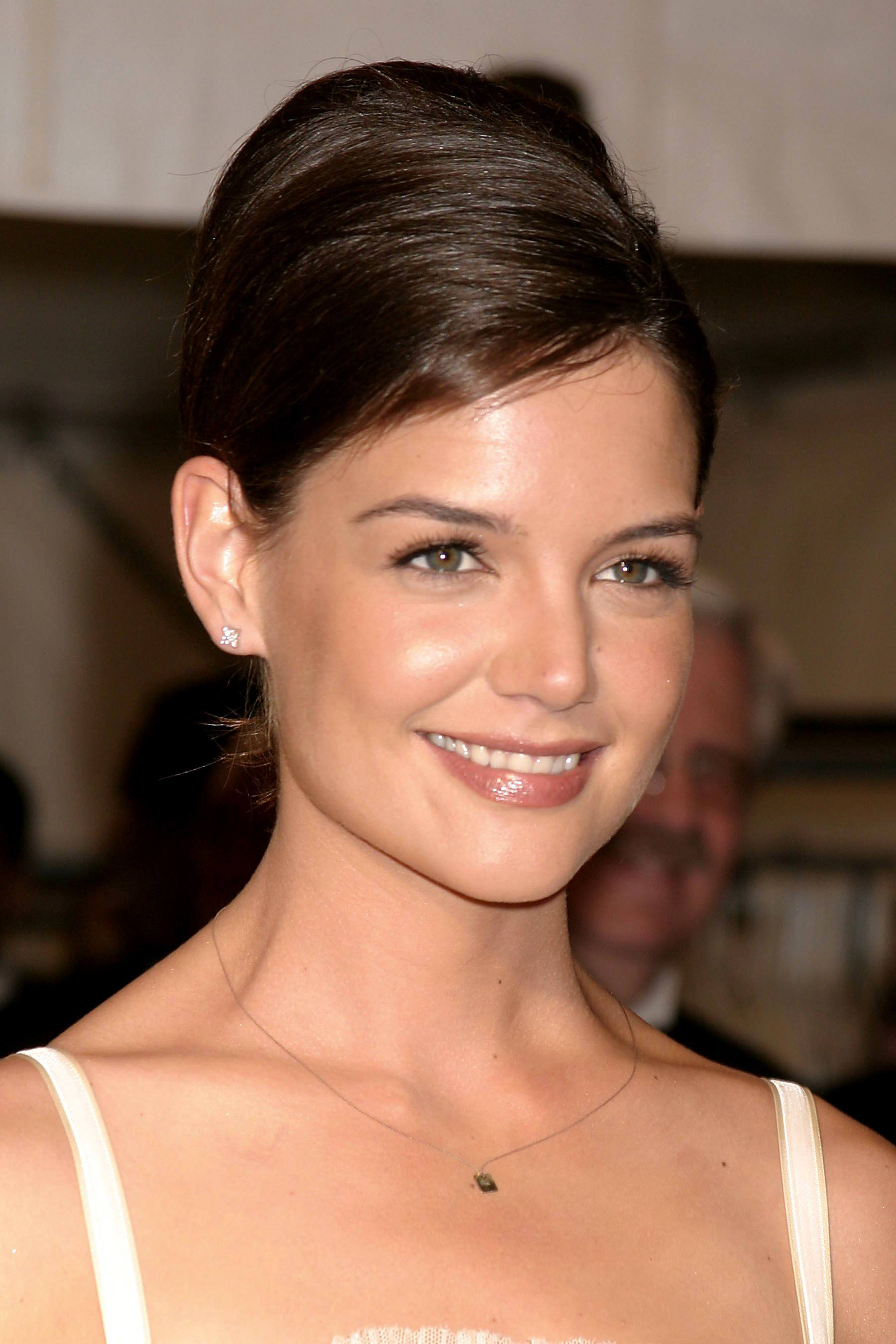 Vintage short hair: Close up shot of Katie Holmes with short chestnut brown hair styled into to smooth beehive