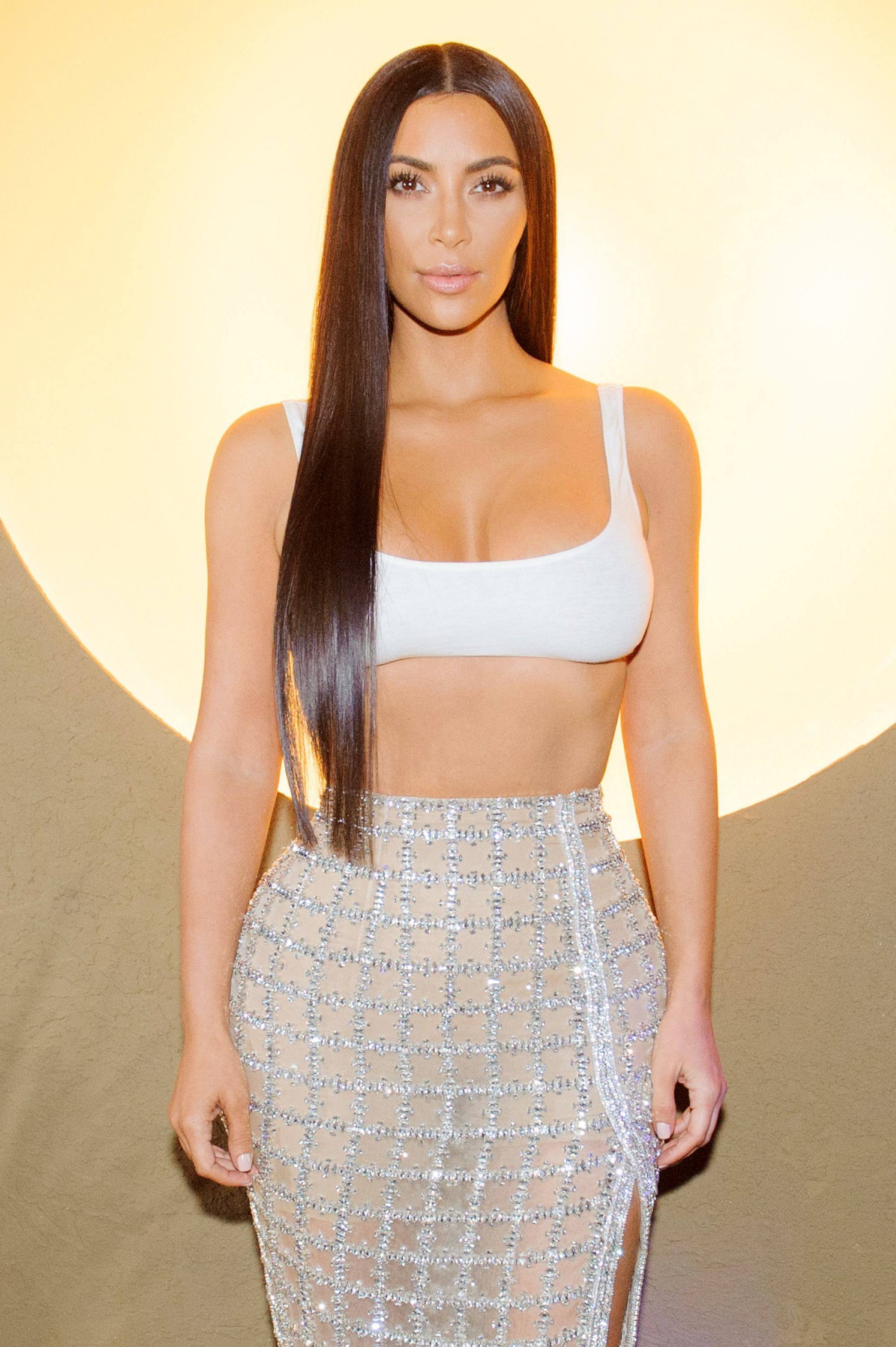 Kim Kardashian rapunzel long straight black hair over one shoulder