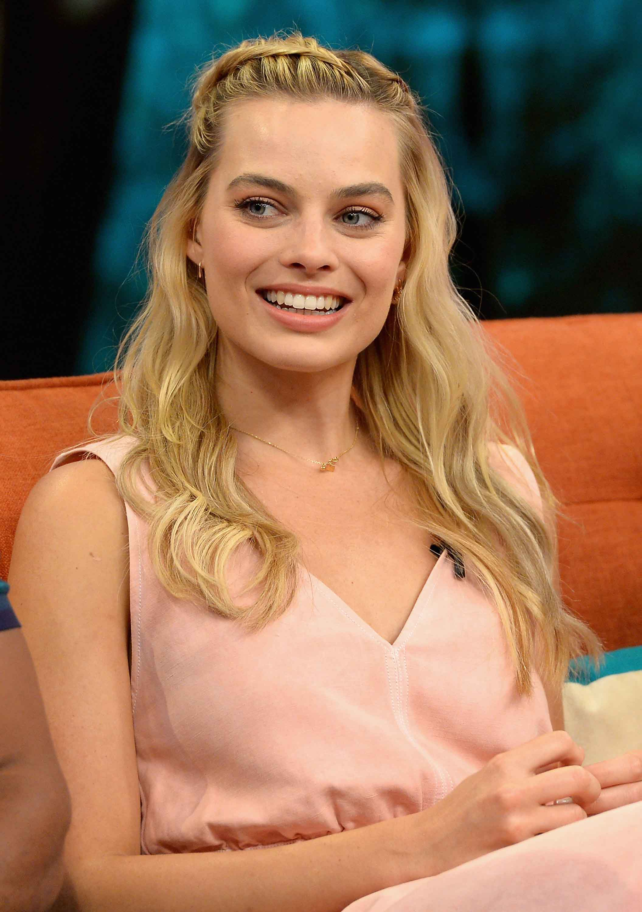 Margot Robbie hairstyles: Side braid and beachy waves. Credit: Getty ...