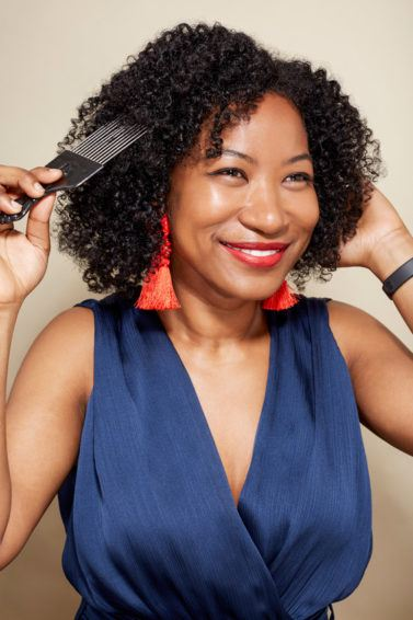 World Afro Day: A young black woman with natural hair and afro pick