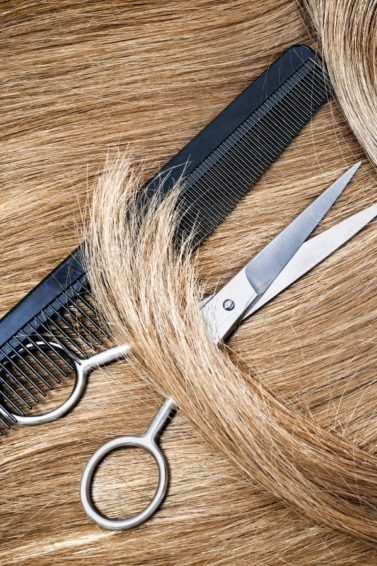 blonde hair with hair scissors and fine tooth comb