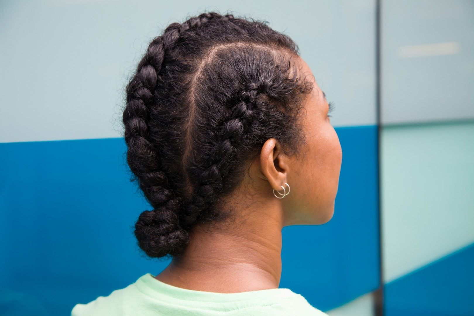cornrow styles: the black view of a young woman with chunky cornrow braids