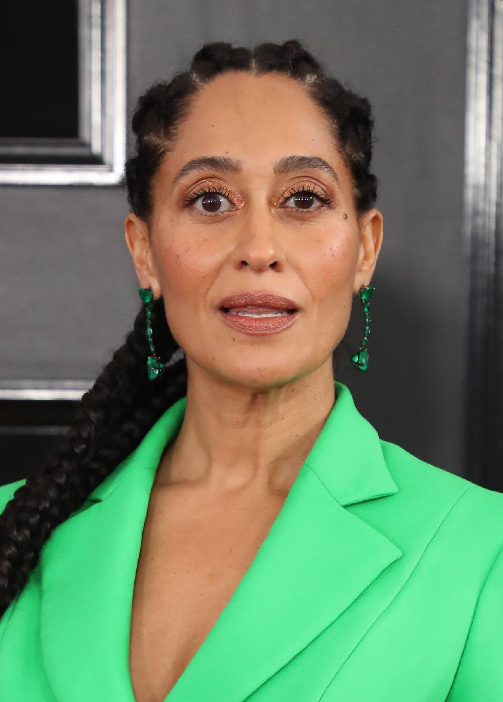 Natural thick hairstyles: Tracee Ellis Ross with long cornrow hairstyle wearing green blazer on the red carpet