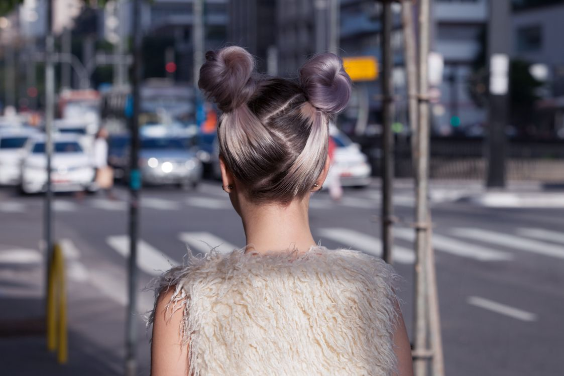 back view of woman with lilac hair and zig zag parted space buns