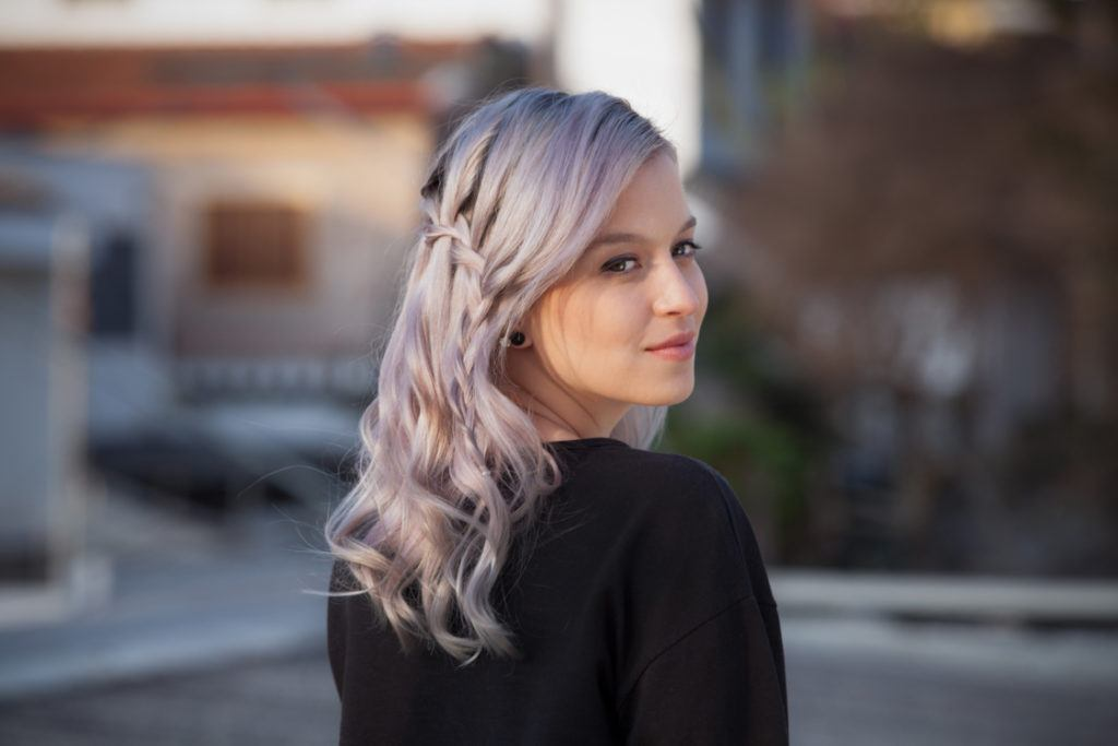 Young woman with light purple coloured hair with waterfall braid for prom