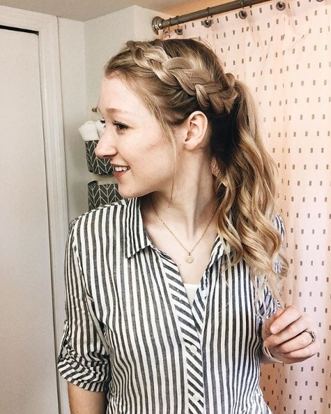 Photo of a blonde woman with a Dutch braided headband braid and a curly ponytail