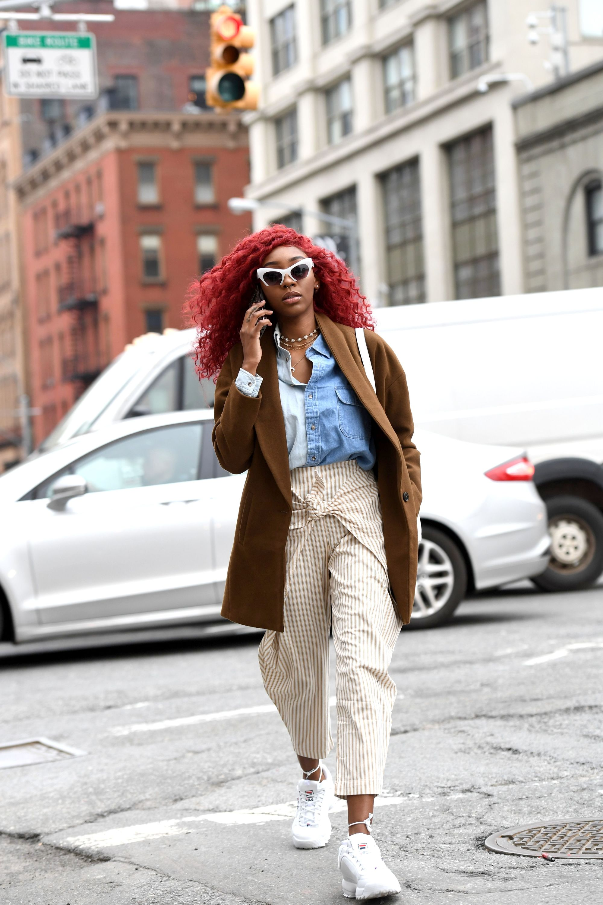 nyfw street style woman with red curly natural hair