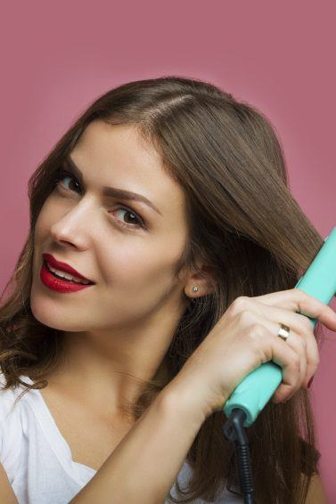 Ceramic hair straighteners: All Things Hair - IMAGE - girl straightening hair