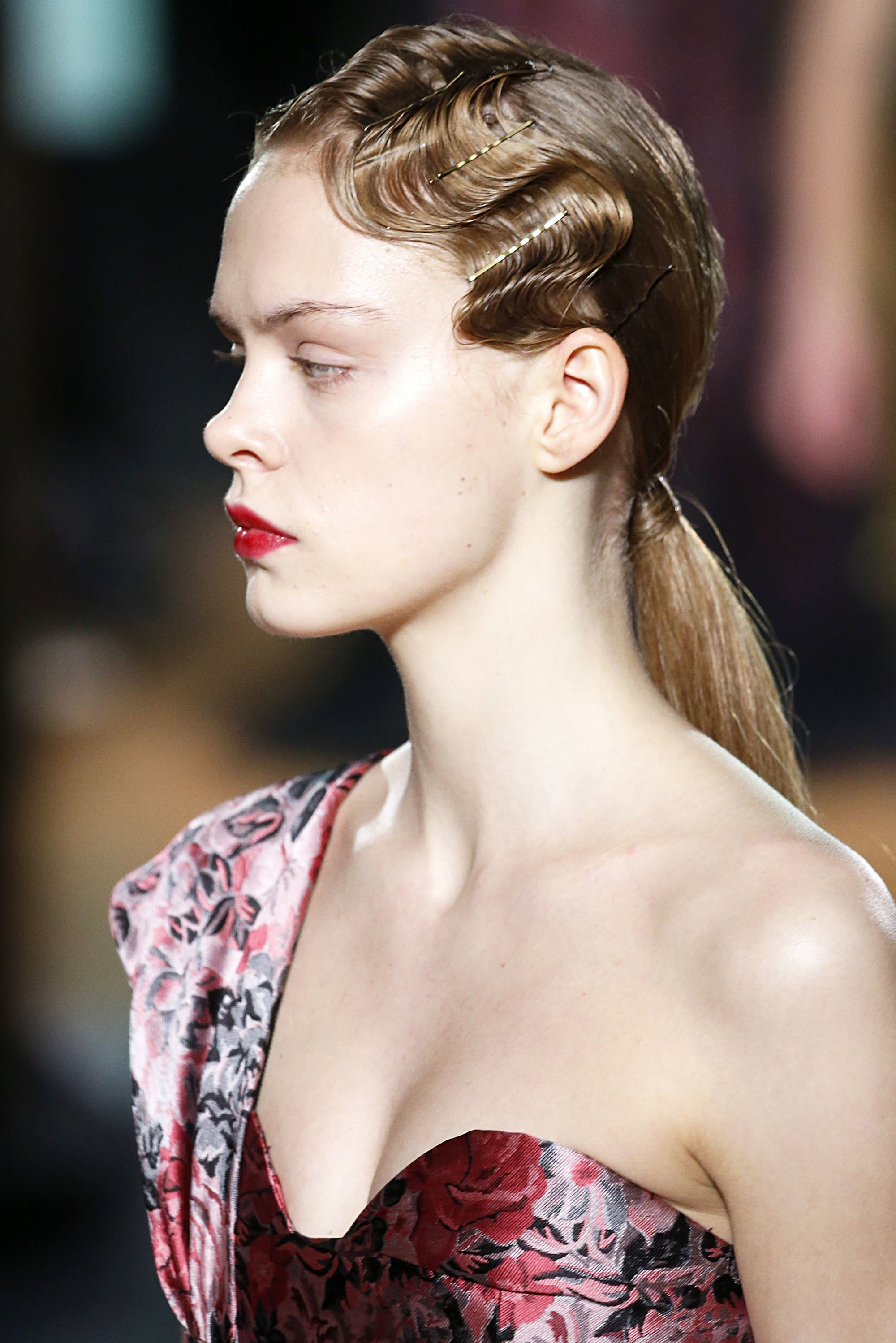 brunette model at erdem's aw18 london fashion week show with finger waves and a low ponytail
