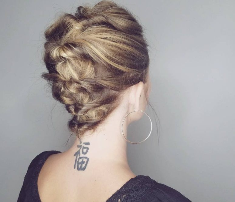 up hairstyles for short hair: woman with french braided updo hairstyle on bob