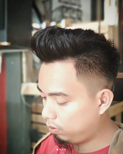 Man with contemporary and subtle dark mohawk hairstyle