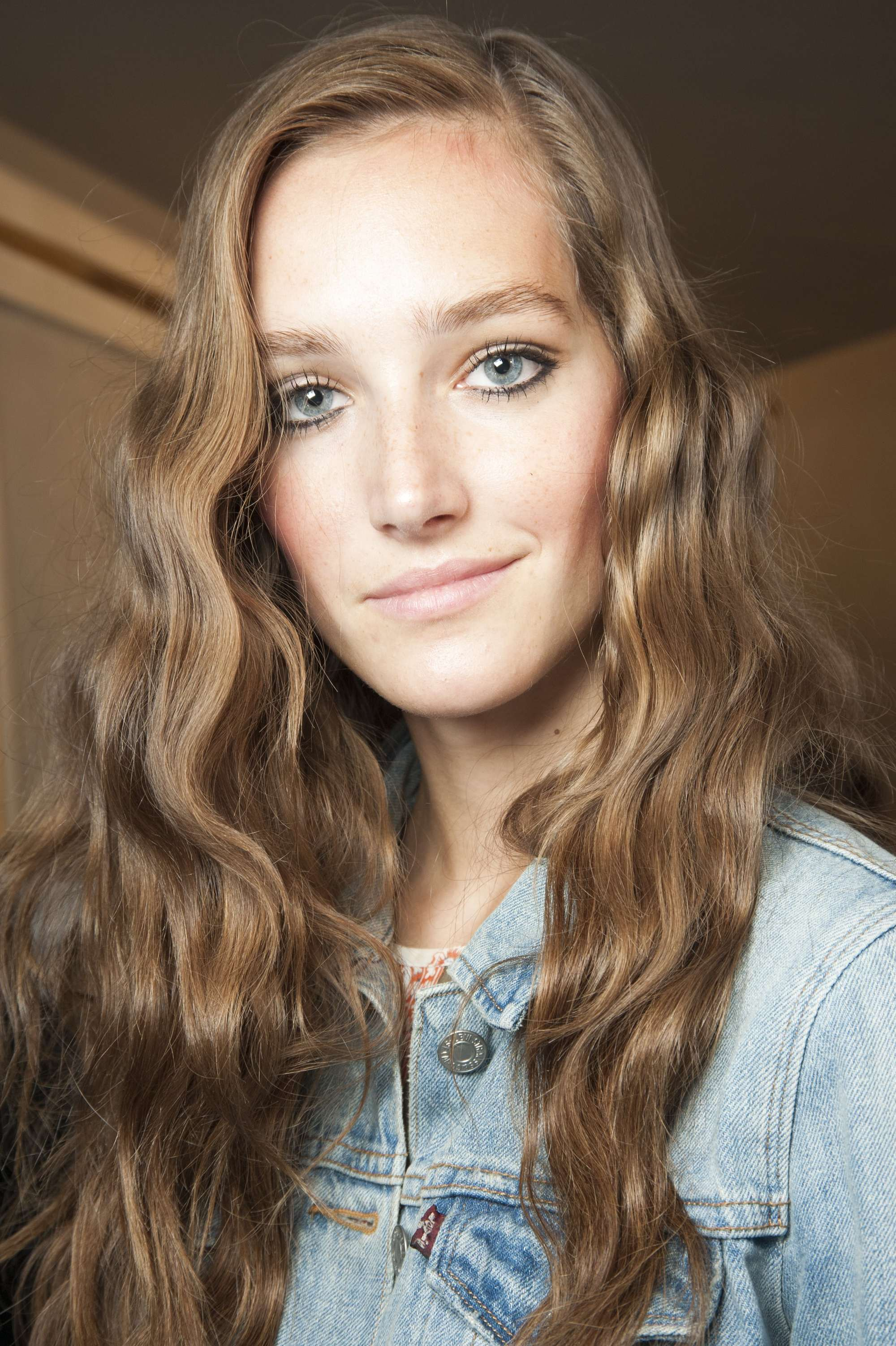 Model Backstage With Sun Kissed Golden Brown Hair