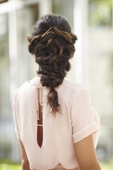 back shot of a woman with long brunette in a mermaid braid