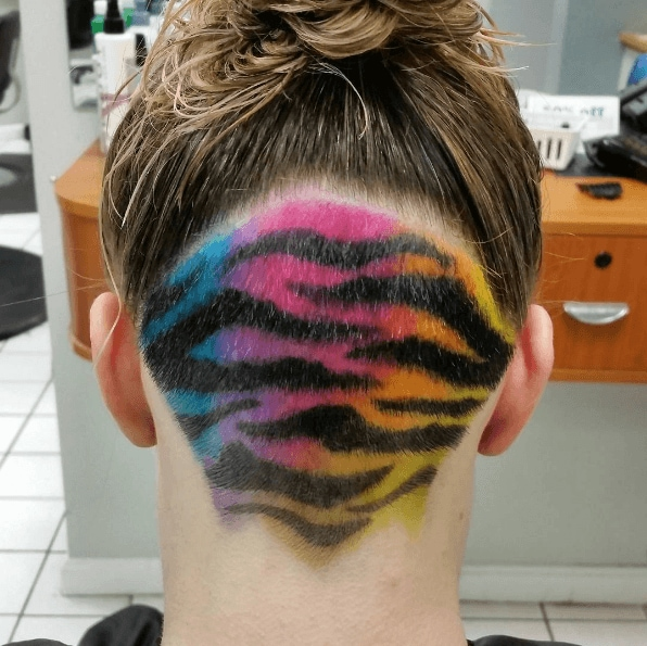 Tiger stripes rainbow colour undercut on woman with brown hair