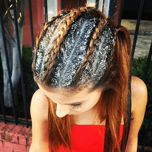 How to dutch braid: Close-up Instagram shot of a woman with copper hair with glitter roots in Dutch braid cornrows