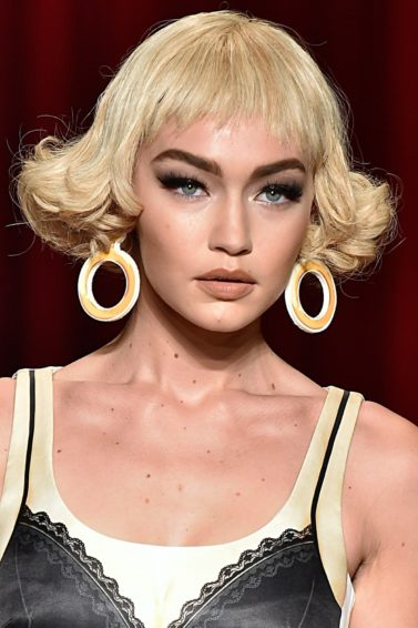 gigi hadid with a blonde curly bob on the moschino ss17 runway