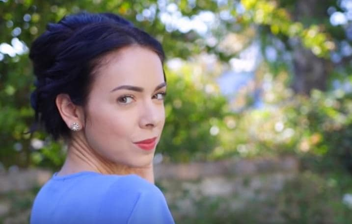 updos for short hair: Nikki Phillippi with brown hair styled in an updo