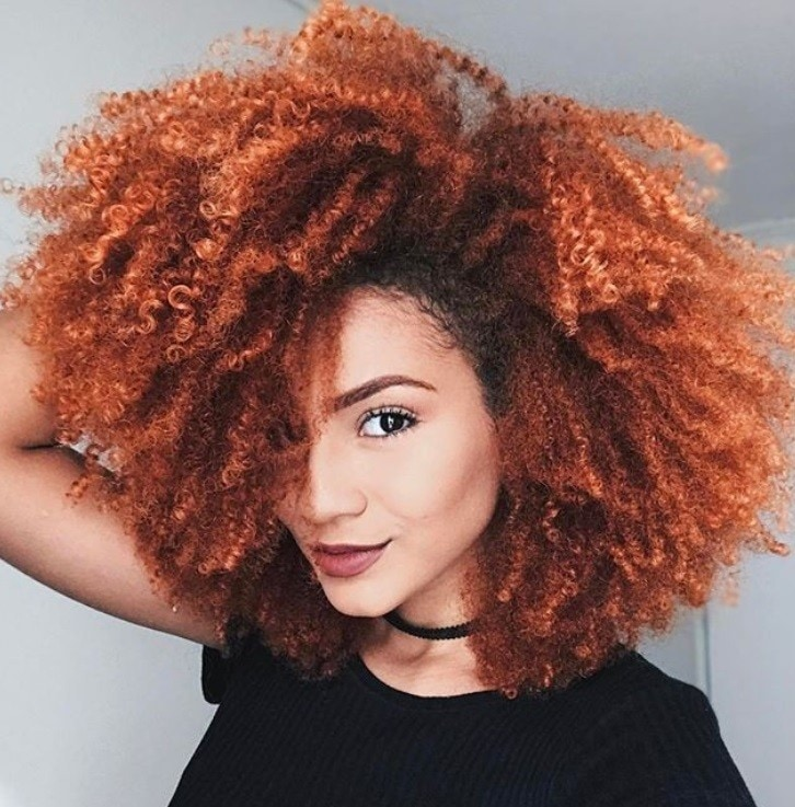 close up shot of woman with curly hair