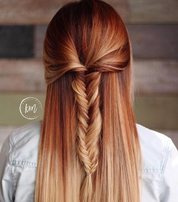 backshot of woman with pumpkin spice hair that's been styled into a half up half down fishtail braid