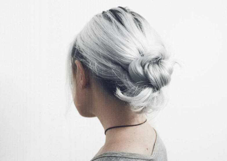 easy updos for short hair: model with short hair styled into knotted updo