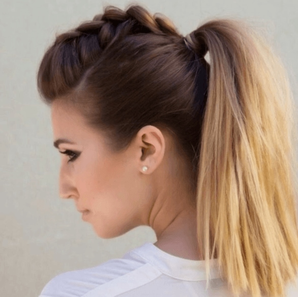 side view of a woman with her hair in a high pony tail with mini faux hawk