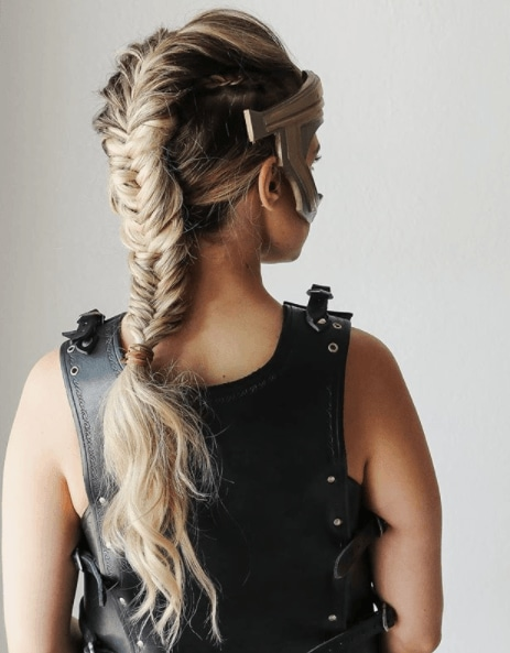 back view image of a woman with long blonde hair in a fishtail braid - faux hawk braid