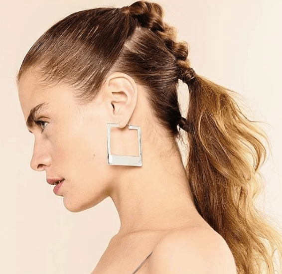 side view of a model with dark blonde hair in braids - faux hawk braid